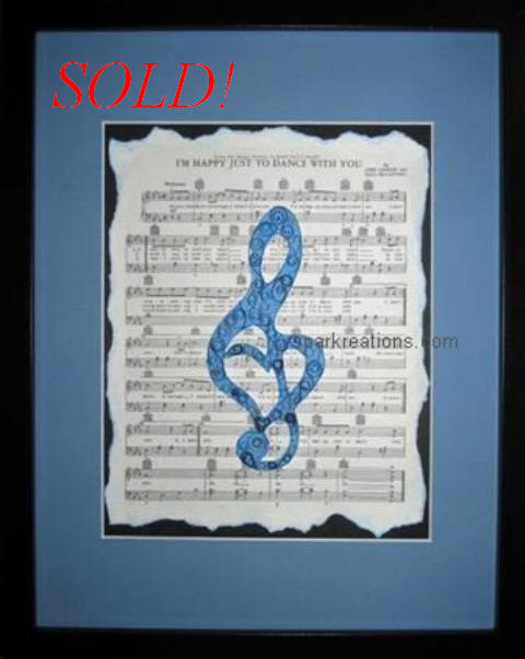 framed quilling...G clef on Beatles sheet music...completed