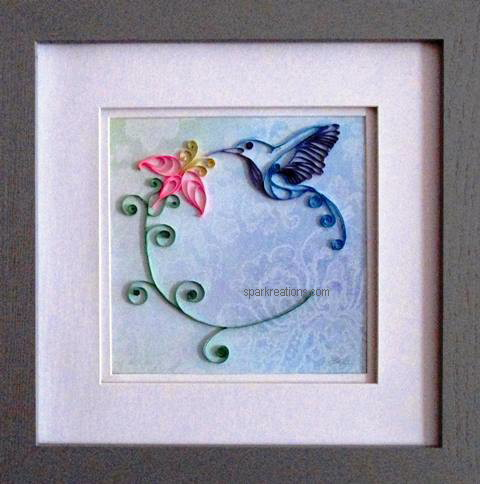 framed quilling...hummingbird with flower
