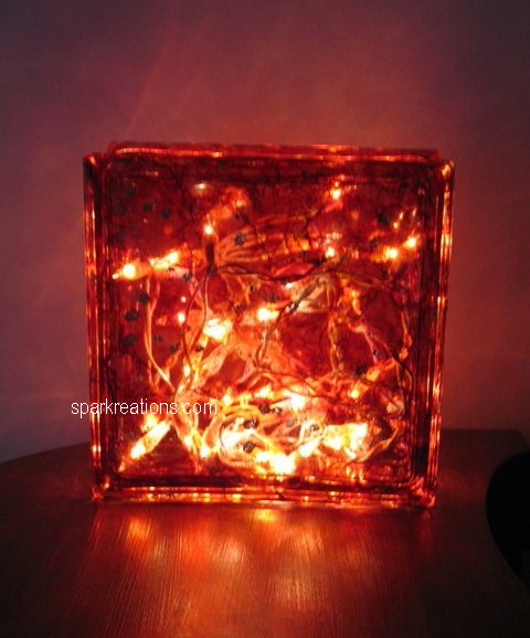 light box (on display)...(cranberry, chili pepper, tangerine, ginger, gold mixative)...1